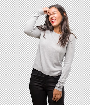 Portrait of young indian woman laughing and having fun, being relaxed and cheerful
