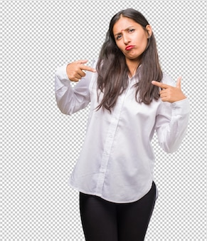 Portrait of a young indian woman proud and confident, pointing fingers, example to follow