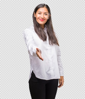 Portrait of a young indian woman reaching out to greet someone or gesturing to help, happy and excited