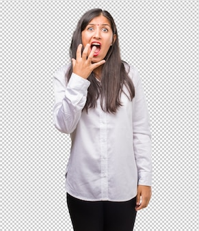 Portrait of a young indian woman very scared and afraid