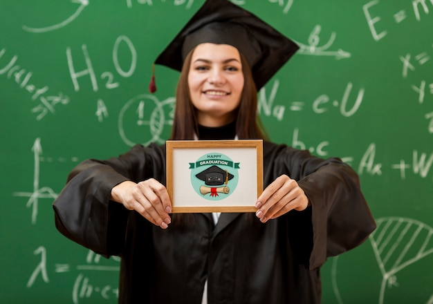 Positive young girl holding diploma