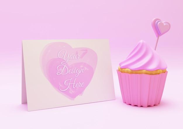 甘いピンクのカップケーキとはがきのモックアップコンセプト