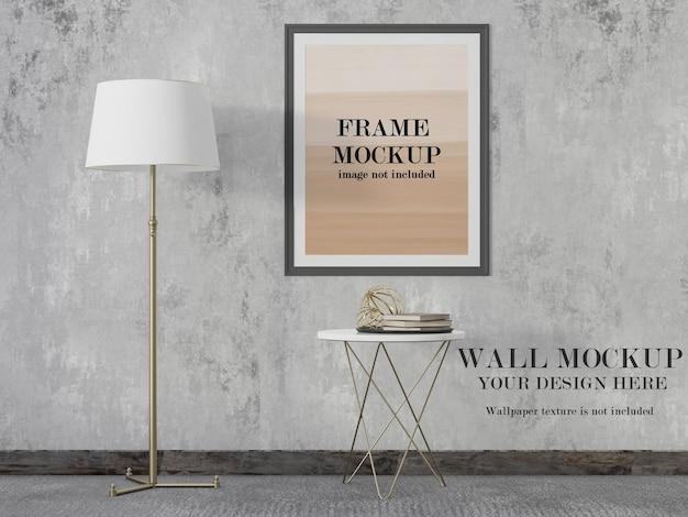 デザイン素材のポスターフレームと壁のモックアップ