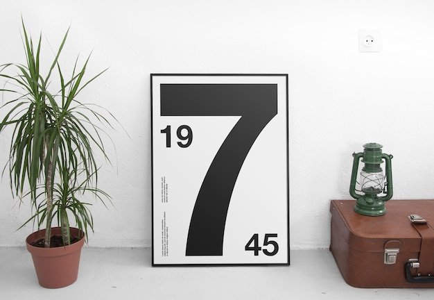 Poster frame mockup with potted plant