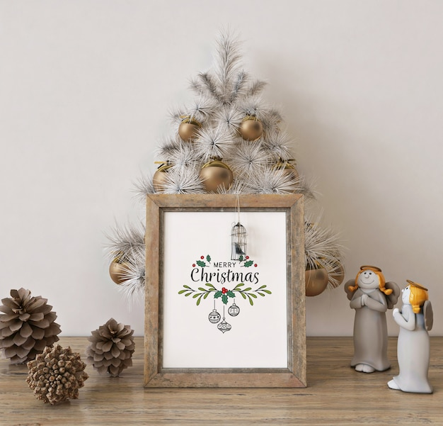 Poster frame mockup with white christmas tree and decoration