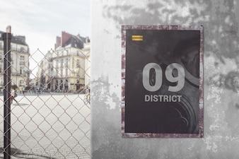 Poster mockup on metal fence