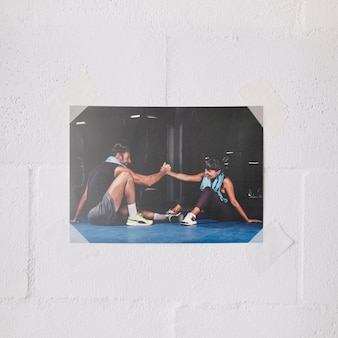 Poster mockup on wall with teamwork and fitness concept