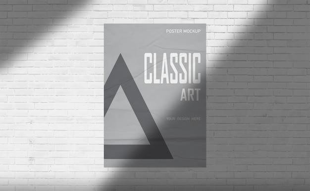 Poster mockup on white brick wall