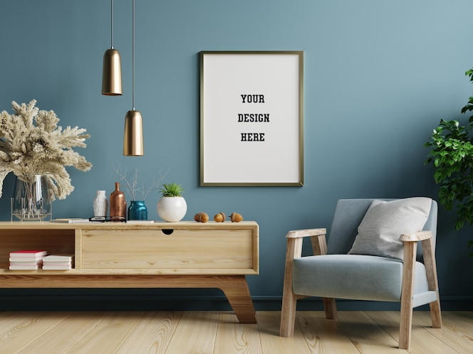 Poster mockup with vertical frame on blue wall in living room interior with blue velvet armchair