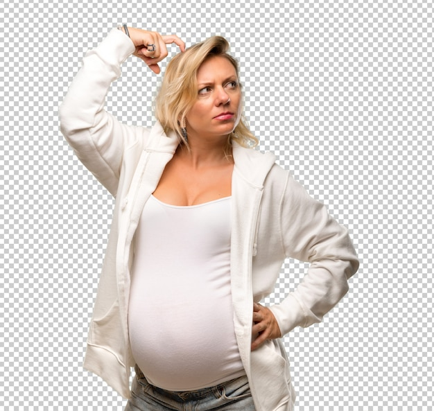Pregnant blonde woman with white sweatshirt standing and thinking an idea