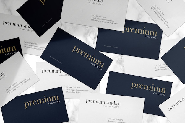 Premium business card mockup on white mable stone and light shadow.