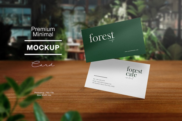 Premium clean minimal business card mockup on wood table in forest cafe and light shadow.