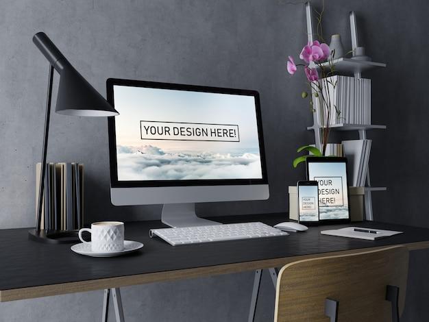 プレミアムデスクトップ、タブレット、そしてスマートフォンが現代的な黒のインテリアワークスペースで編集可能な画面でデザインテンプレートをモックアップ
