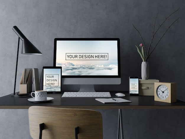 Premium desktop, tablet, and smartphone mock up design template with editable display in black interior workplace