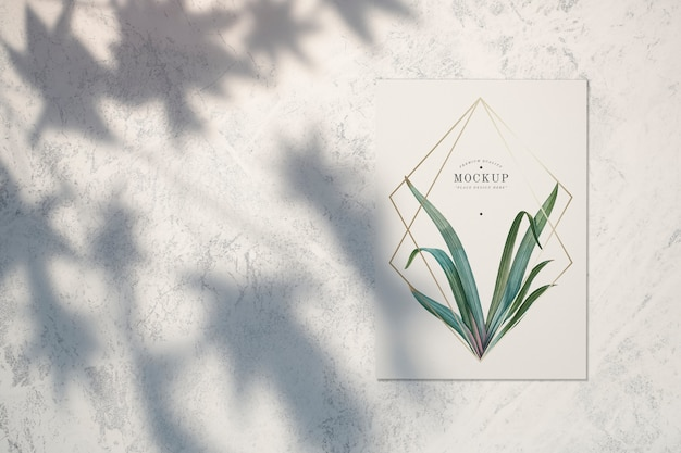 Premium quality card mockup with leaves and golden frames