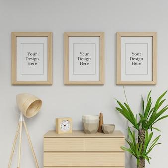 Premium triple a2 poster frame mock up design template hanging portrait in home interior