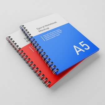 Premium two a5 office hard cover spiral binder notebook mockup design template stacked in top left perspective view