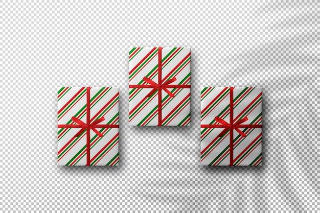 야자수 잎 그림자가 있는 크리스마스 컨셉의 선물 상자 모형