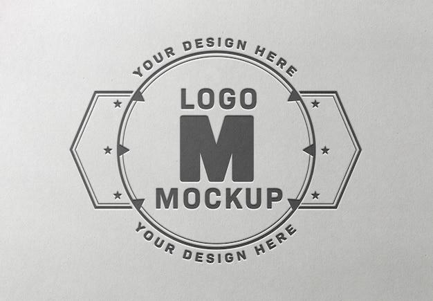 Pressed logo mockup on white paper texture