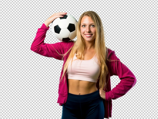Pretty sport woman holding a soccer ball