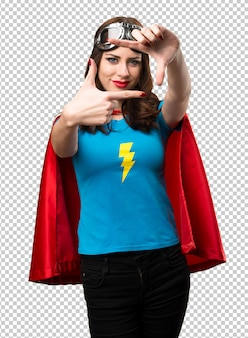Pretty superhero girl focusing with her fingers
