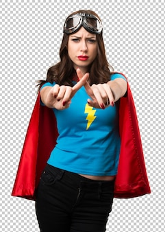 Pretty superhero girl making no gesture