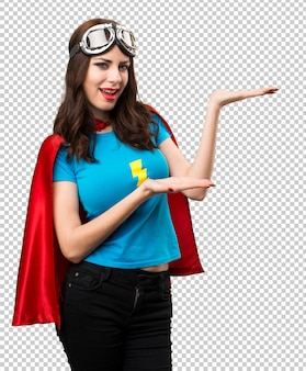 Pretty superhero girl presenting something