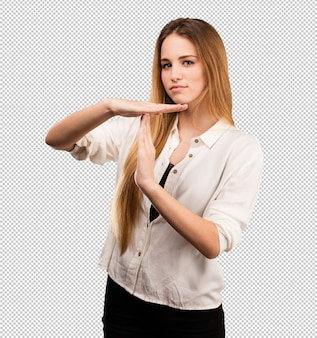 Pretty young woman doing time break gesture