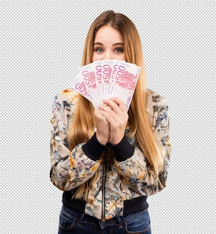 Pretty young woman holding bills