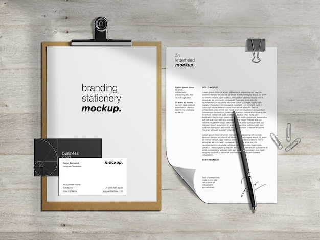Professional branding identity mockup template with clipboard,  letterhead and business cards on wooden desk
