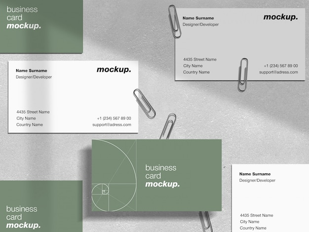 Professional business cards with paper clips and shadow overlay mockup