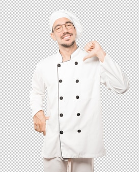 Proud young chef making a haughty gesture