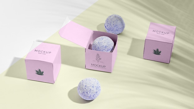 Purple bath bombs in pink boxes
