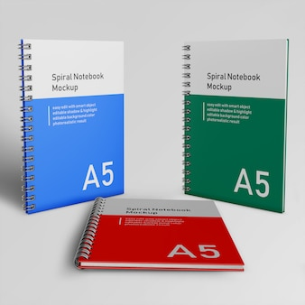 Ready to use three corporate hard cover spiral binder notepad mock ups design templates standing and resting in front perspective view