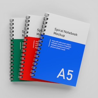 Ready to use triple bussiness hardcover spiral binder a5 notebook mock up design template stacked in top view