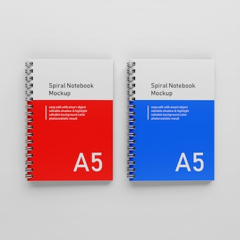 Ready to use two bussiness hard cover spiral a5 binder notepad mockups design templates side by side in top view