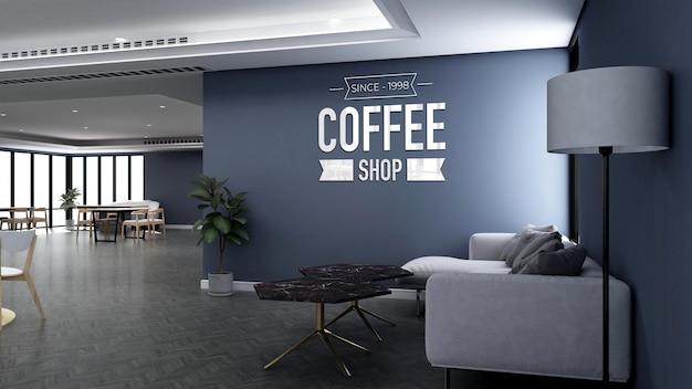 소파가 있는 커피숍에서 현실적인 3d 벽 로고 모형