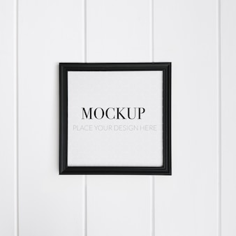 Realistic black frame on white wall for mockup