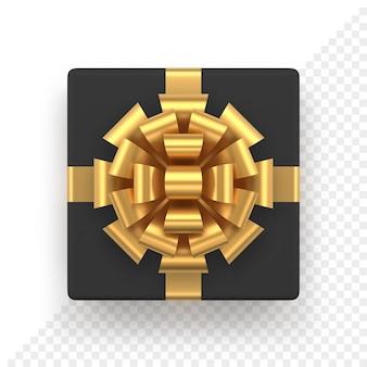 金色の弓が付いたリアルな黒のギフトボックス。クリスマスと新年の装飾のための上面図の正方形のプレゼント。販売バナーやグリーティングカードのために白で隔離の装飾的なお祝いのオブジェクト。