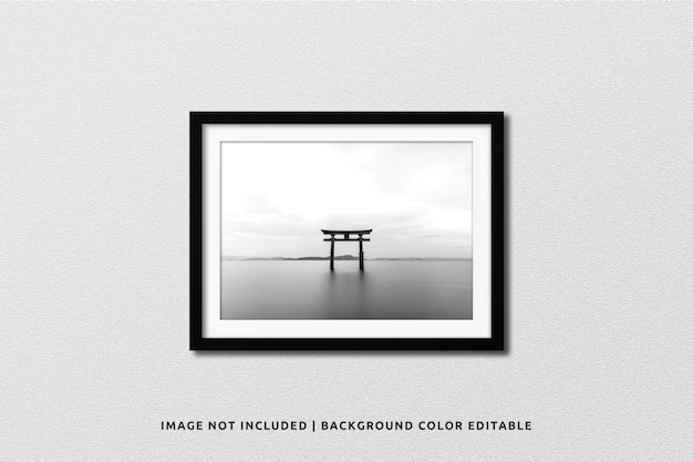Realistic black landscape photo frame mockup on wall