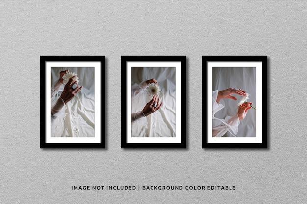 Realistic black portrait photo frame mockup on wall