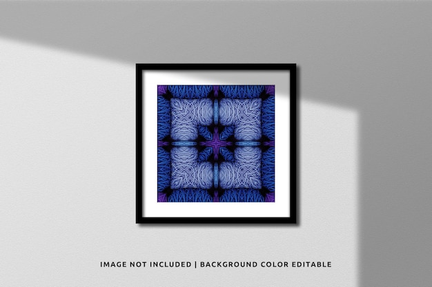 Realistic black square photo frame mockup on wall