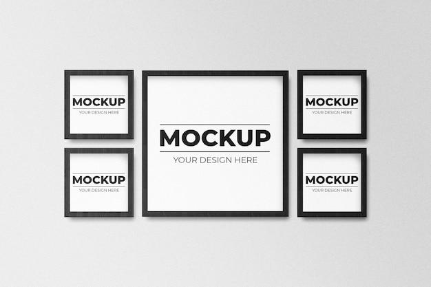 Realistic black square photo frame mockup on wall