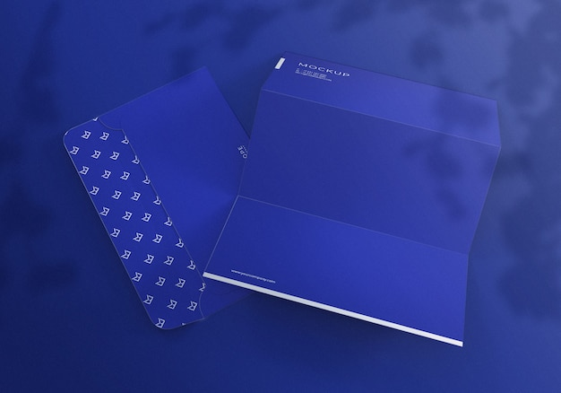 Realistic blue envelope and letterhead set mockup