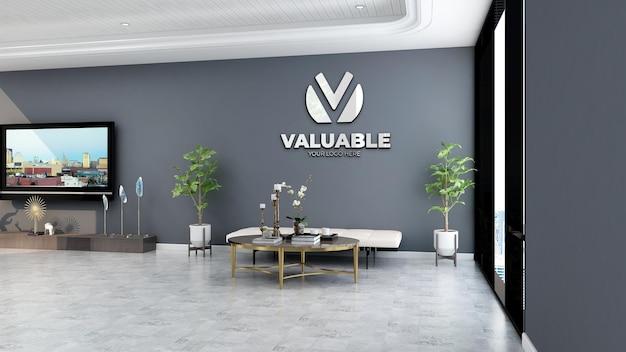 회색 벽이 있는 사무실 로비 대기실의 실제 회사 벽 로고 모형