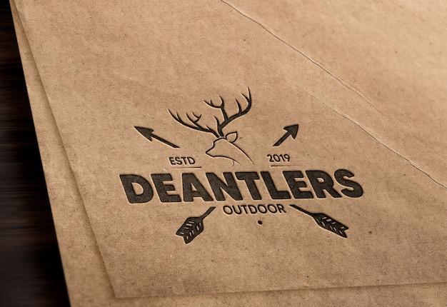 Realistic debossed logo mockup in brown paper
