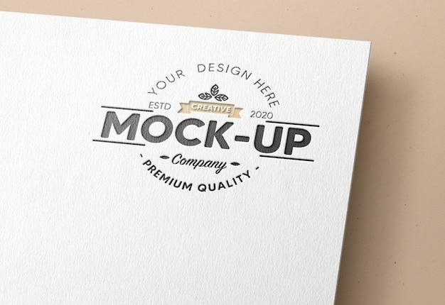 Realistic debossed logo mockup in white paper