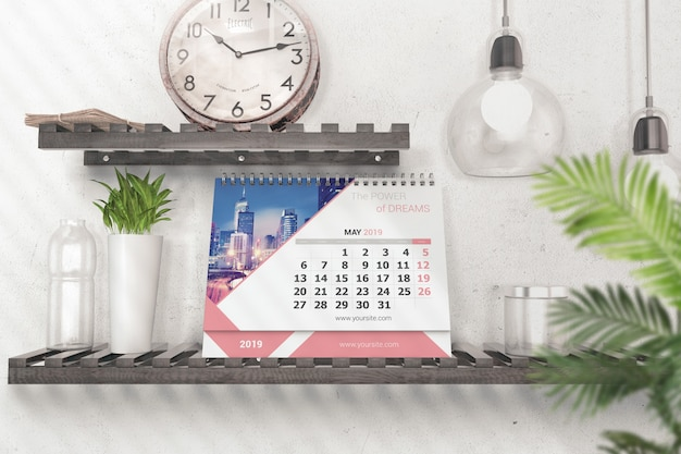 Realistic desk calendar on shelf mockup