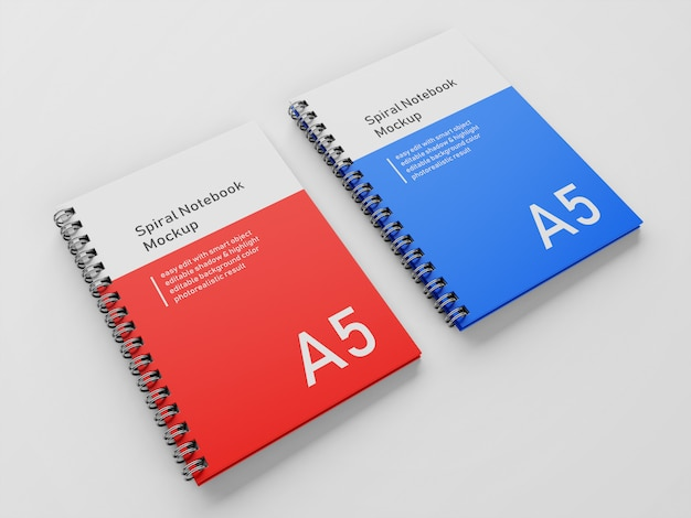 Realistic double corporate a5 hardcover spiral binder notebook mock up design template side by side in 3/4 perspective view