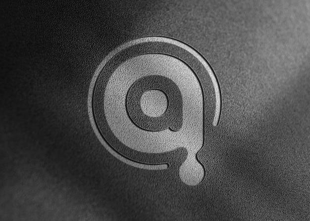 Realistic embossed logo mockup on wall